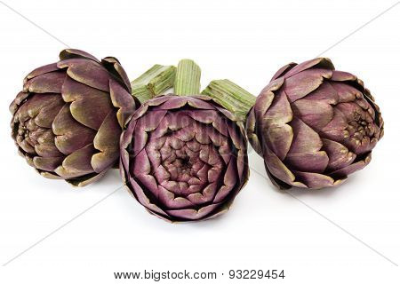 Three Artichokes On White Background