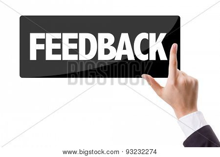 Businessman pressing button with the text: Feedback