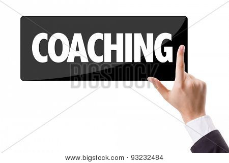 Businessman pressing button with the text: Coaching