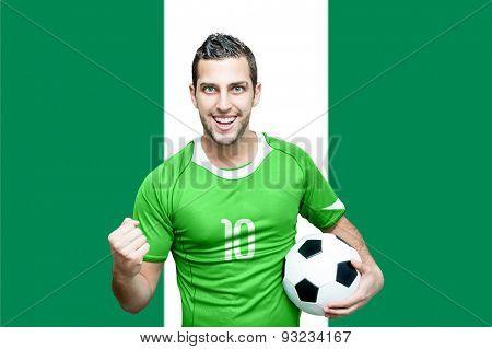 Nigerian fan celebrates on Nigeria flag background