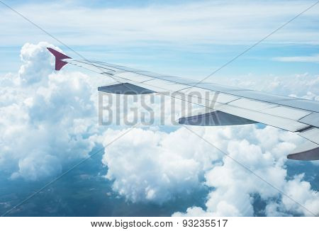Clouds and sky as seen through window of an aircraft.