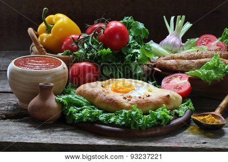 Still-life With A Pie And Ljulja-kebab Submitted With Fresh Vegetables And Tomato Sauce