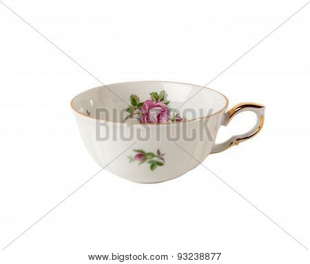 Porcelain teacup with floral rose ornament in classic isolated on white
