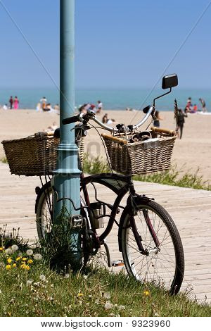 bicycle on boardwalk by the beach