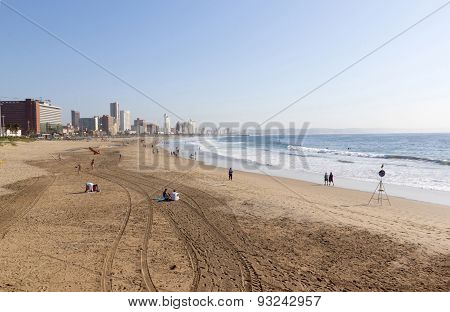 Early Morning Tyre Tracks On Beach In Durban