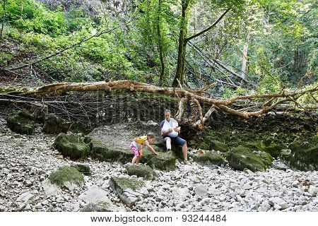 Little Girl Climbing Stones, Showing Off To Her Mother