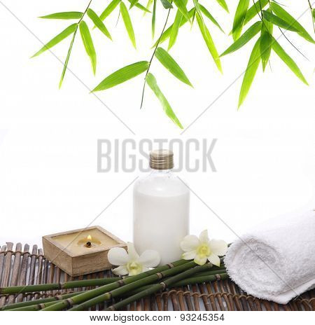spa concept with grove and candle, towel, oil ,orchid and bamboo leaf