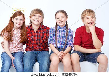 Smiling friends sitting together