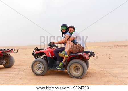 Young Couple Riding Sand Atv