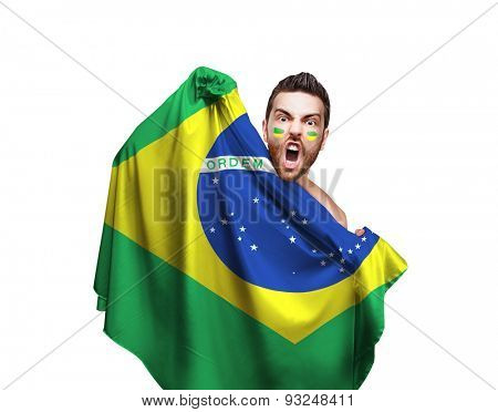 Fan holding the flag of Brazil on white background