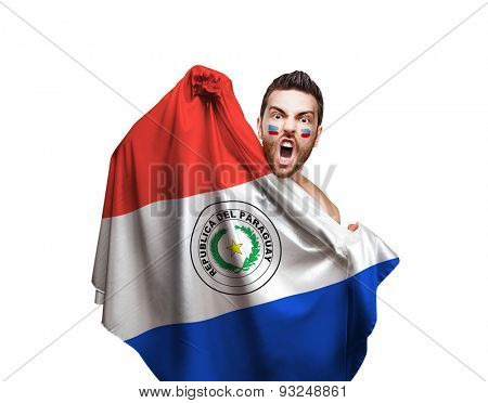 Fan holding the flag of Paraguay on white background