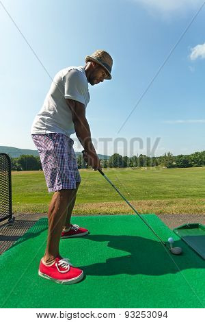 Golfer Teeing Up at the Driving Range