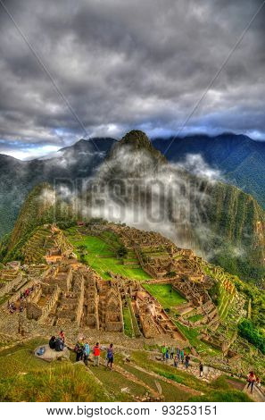 Portrait Picture Of The Cloudy Weather In Machu Picchu In Hdr