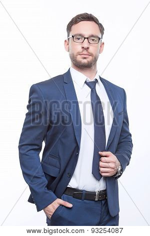 Young bearded businessman on white background