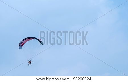 Motorized Paraglider Flying In The Sky