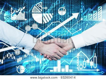 Handshake Over The Digital Screen With Charts And Graphs. A Concept Of Capital Market Transactions.