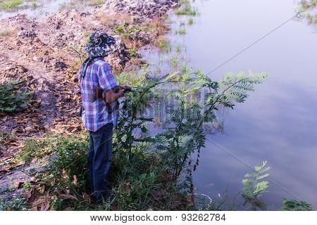 Asia Fishman With Gun