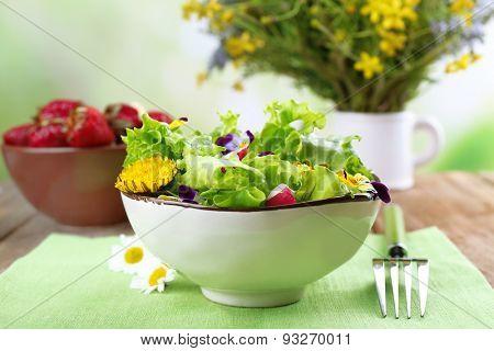 Light organic salad with flowers, close up