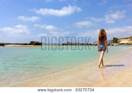 Young Girl Walking On The Beach