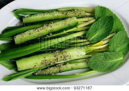 Green salad with cucumber and wild leek, closeup