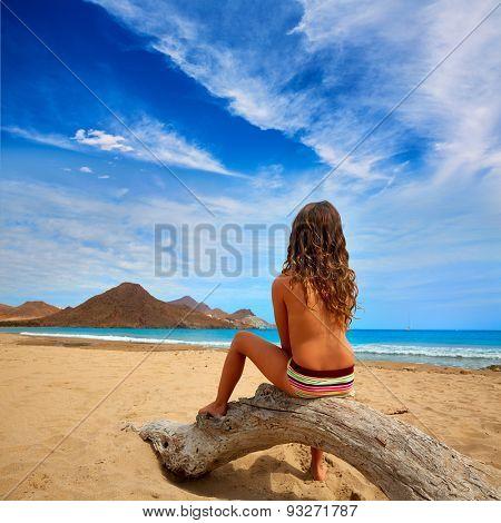 Almeria Playa de los Genoveses beach girl back in Cabo de Gata Spain