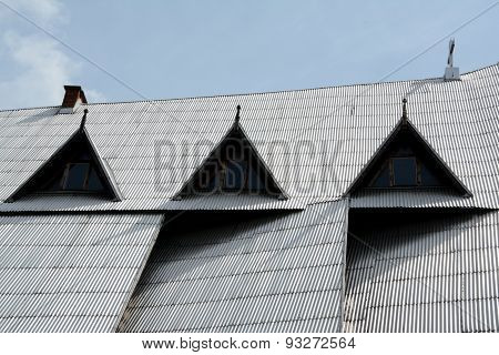 Steep Roof Covered With Silver Corrugated Plates.