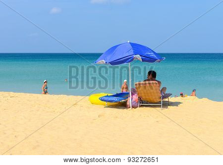 The Leisure Of Tourists On The Beach