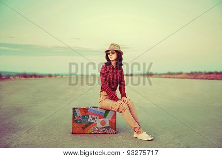 Traveler Sitting On Suitcase Outdoor