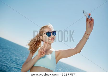 Happy Fitness Selfie Blonde Asian Girl Smiling And Taking Self Portrait Photograph With Smart Phone