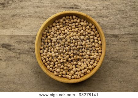 Bunch Of Chickpeas In Bowl On Old Wooden Background. Indian Cuisine