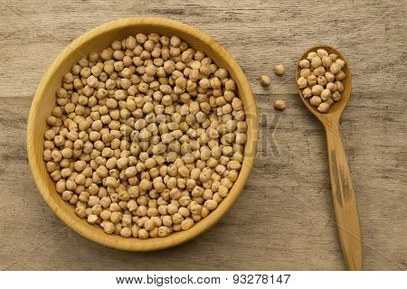 Bunch Of Chickpeas In A Bowl And Spoon On Old Wooden Background. Indian Cuisine