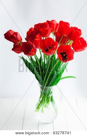 Red Tulips Glass Gar On Wood Table