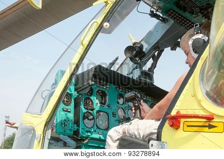 Little boy sitting in cabin of the MI-8 helicopter