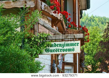 Guestrooms Sign On Wooden Board