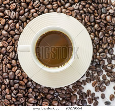 Coffee Cup And Saucer On A Wooden Table. Black Background.