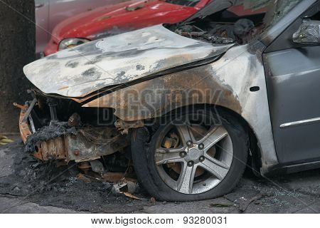 Side Of A Burnt Out Car In An Outdoor Park