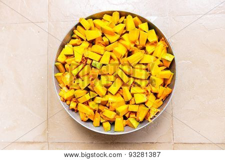 Finely chopped pumpkin kept in a vessel ready to be cooked