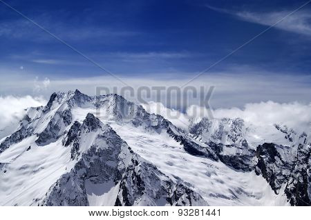 Snowy Mountains In Clouds