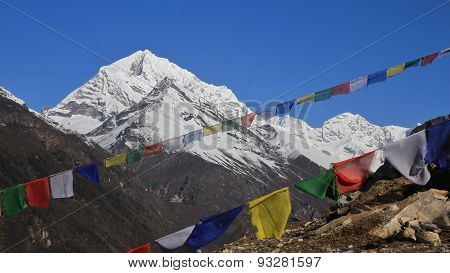 Colorful Prayer Flags And Snow Capped Mountains