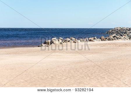 Sandy Coast Of The Sea With Horizon And Stones