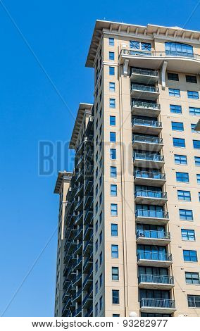 Balconies On Yellow Plaster Condos