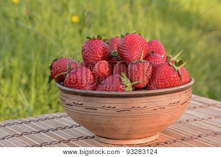 Strawberries In A Clay Bowl