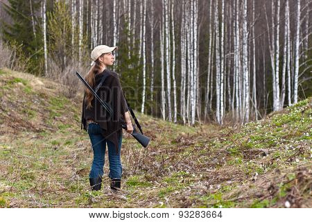 Woman Hunter With Gun In Forest