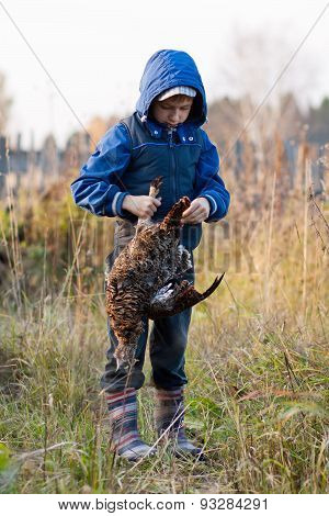 Boy With Black Grouse