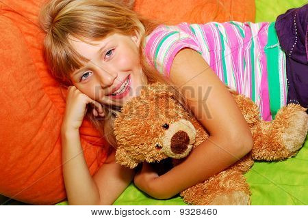 Happy Girl With Her Teddy Bear