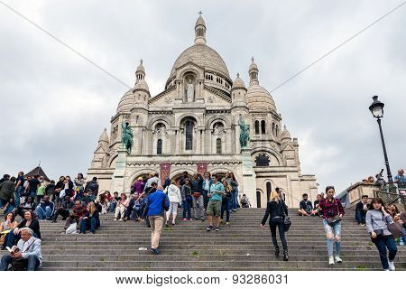 Tourists Climbing Stairs Of Sacre Coeur At Paris, France