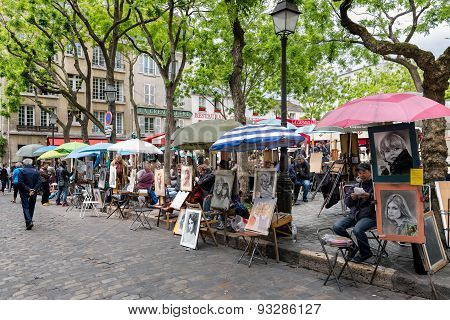 Place Du Tertre In Paris With Artists Ready To Paint Tourists