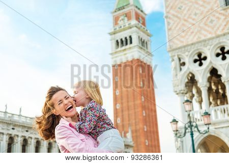Laughing Mother Being Kissed By Daughter On St. Mark's Square