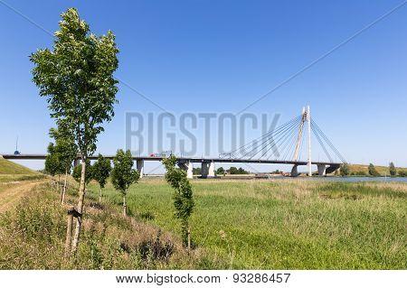 River Ijssel With Bridge Near Kampen In The Netherlands