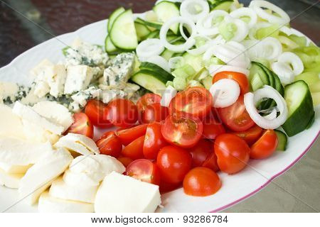 Big Plate Full Of Fresh Vegetable And Two Kinds Of Cheese
